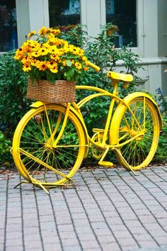 yellow bike & flowers yellow flowers, color, yard art, flower baskets, vintage bicycles, planter, old bikes, garden sculptures, front porches