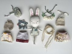 Beautiful handmade cloth bunny rabbitpersondoll and clothing playset. She has hand embroidered details on her face. She loves to go to tea parties, cuddle and make new friends. DETAILS:♥About 8.5 inches tall. From tip ofears to feet. ♥ She comes with a striped linenskirt sewn with french seams and flower headpiece. Or you can also have acrochet romper, hand knit scarf, crochet collar, pom pom headpiece, sequin skirt, and hand knit top. ♥ Body fabric is 100% cotton. Her clothing yarns…