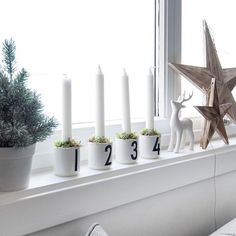 Love this beautiful Christmas window by @enkontrast. Design Letters candle holders are available in our online store.