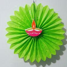 Diwali decor ideas Stick diya cut outs on brightly coloured rosettes www.facebook.com/confetti16