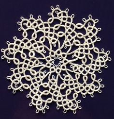 "Occasionally a ""snowflake"" which doesn't have six sides slips through.this one is Mary Konior's Spinning Wheel Glass Mat (aka a coaster) f. Shuttle Tatting Patterns, Needle Tatting Patterns, Filet Crochet, Crochet Doilies, Tatting Lace, Embroidery Needles, Yarn Projects, Bobbin Lace, Crochet Hooks"