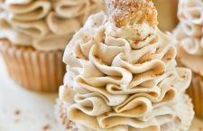 Dreamy cinnamon and vanilla cupcakes with Cinnabon Cinnamon Cream Cheese Frosting and a sugary churro on top!  To date, these churro cupcakes are my favori