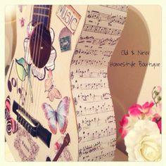 An ordinary guitar painted in chalk paint & decoupaged with old & new cut out prints with a musi & shabby chic twist :)