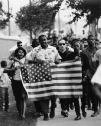 Father James Groppi leading a fair housing march, 1966