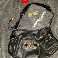Gia Milani side studded sml satchel Leather , inner zip pkt, 2 slide pkts, studded sides, 100% sales go to a family from fraud. A single mom and her 3 kids were left destitute by her ex husband after he fled indictment by the FBI. No child support/alimony and no warning. Their whole life was a lie and now their left to pick up the pieces through foreclosure and repossession suffering his consequences as he runs free. Gia Milani Bags Satchels