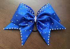 A personal favorite from my Etsy shop https://www.etsy.com/listing/294753295/cheer-bow-fabric-sewn-royal-blue
