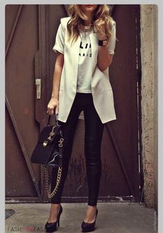 Casual logo T dressed up with white/cream longline waistcoat, leather skinnies & heels.