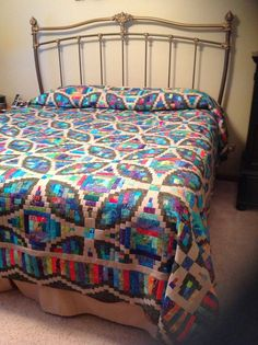 Judy Martin pattern (Finger Lakes Log Cabin from Judy Martin's Log Cabin Quilt Book). Made by me (Debi Wight). Her patterns are amazing and go together so well. Thank you Judy.: