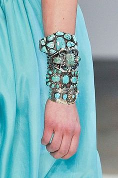 Turquoise bracelets and cuffs go beautifully with turquoise dress