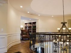 Like the circular walkway around top of stairs. Peyton Manning's home.