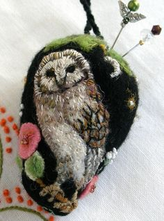 I ❤ pincushions . . . Wool Owl- Lots of tiny stitches create a little owl portrait. ~By Fiberluscious