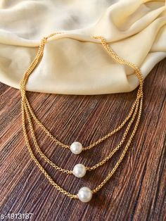Necklaces & Chains Women's Pearl And Gold Plated Necklaces & Chains Material: Alloy  Size: Free Size Length : 18 in Description: It has 1 Piece of Necklace Work: Embelished & Beads Sizes Available: Free Size *Proof of Safe Delivery! Click to know on Safety Standards of Delivery Partners- https://ltl.sh/y_nZrAV3  Catalog Rating: ★3.9 (8319)  Catalog Name: Women's Alloy Gold Plated Necklaces & Chains CatalogID_252325 C77-SC1092 Code: 831-1913187-