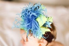 Turquoise Lime Leopard Over The Top Bow by loveablebabyboutique, via Etsy.