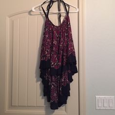 Free People Blouse Floral open back blouse. Only been worn a couple times. It is a high-low top. There are long straps that can be tied around the neck or threw the loop on the back of top. There's distressed edging at the top of the blouse. Free People Tops Blouses