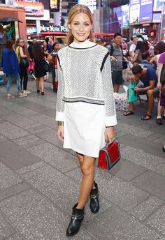 Olivia Palermo wears as shirtdress, polished sweater, ankle boots, and a top-handle bag