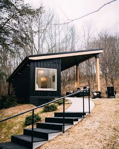 Nestled on 13 acres of woods, this adorable shipping container is inspiring. Dubbed The Lilypad and located a couple miles from the entrance of Old Man's Cave in Logan, Ohio, we love its black facade and cozy interior. Let's take a look! Tiny House Cabin, Tiny House Living, Tiny House Plans, My House, Tiny Guest House, Guest Houses, Container House Plans, Container House Design, Tiny House Design