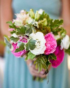 38 Ideas for Your Bridesmaids' Bouquets   Martha Stewart Weddings - Each 'maid at this wedding carried a bouquet of white and pink roses with trailing vines designed by Bash Please. #weddingbouquets