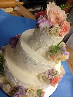 By Reva Alexander-Hawk, Swiss Meringue Buttercream cake with fresh flowers, rustic wedding cake