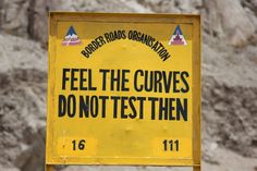 """Road sign in Ladakh, """"Feel the curves - do not test then"""""""