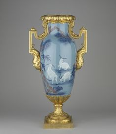 """1750 Chinese Vase in the Royal Collection, UK - From the curators' comments: """"A tall baluster-shaped pale blue Chinese porcelain vase, painted with white rams among rocks beneath a pine tree and bamboo at the front and with five bats at the back. The depictions symbolise spring and happiness. The vase is decorated with French gilt-bronze mounts dating circa 1760-1770."""""""