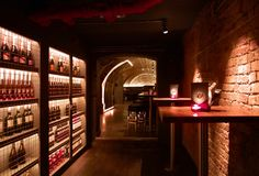 Paul Nulty Lighting Design - Adventure Bar, Covent Garden - Subterranean Interior Merchandise Display Illumination