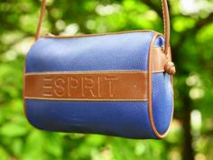 This is a totally cool Esprit bag from the 1980s.    Its made of synthetic cowhide in royal blue and features the ESPRIT embossed logo across the