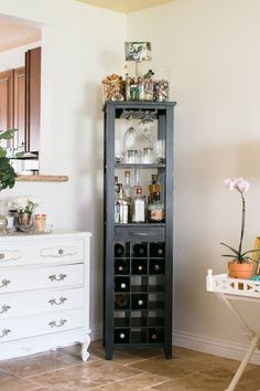 Corner shelf for bar, shelving display, or extra kitchen things -------------------------------------------Kathleen Barnes' Orange County Home Tour #theeverygirl