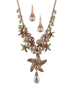 Amabel Designs Crystal & Faux Pearl Starfish Statement Necklace & Earring Set | zulily   . $32.99 $95.00 Product Description:  Double the shine to your outfit in this starfish-studded set. Faux pearls and crystal accents exude an ocean of shimmer.      Includes necklace and earrings     Necklace: 16'' L with 3'' extension; 6'' drop     Lobster claw clasp     Earrings: 0.4'' W x 1.25'' L     Rose gold plated zinc alloy / crystal     Imported
