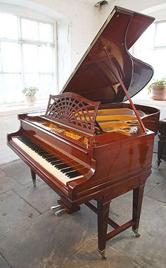 A 1913, Bechstein Model B Grand Piano For Sale with a Mahogany Case with Stringing Inlay at Besbrode Pianos. Piano Formerly Belonged to British Music Hall Singer Ronnie Ronalde. Ronnie Ronalde (born Ronald Charles Waldron, 1923, London) is a British music hall singer and siffleur. Ronalde is famous for his voice, whistling, yodelling, imitations of bird song and stage personality.
