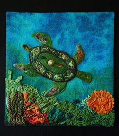 Key Largo by Barb Forrister $395 Painted on damask cloth. The turtle is painted, appliqued, needle felted, embellished with beads and trinkets, heat distressed cellophane and textiva.  Soft sculpted coral and sea anenomes consist of of dyed lace, trims, bullion and painted, heat distressed tyvek. Beaded fish. This piece is hand and machine appliqued, machine #quilted with metallic and trilobal polyester thread. Key Largo is part IV of Emerald Treasures series #Art #wildlife #nature