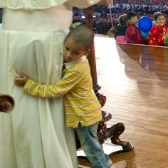 Pope Francis had an unexpected companion onstage at the Vatican last weekend. Catholics from all over the world gathered to celebrate the Year of Faith, but one little boy wanted to be closer to the Holy Father.