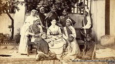Dressing the Indian woman through history - Photograph of a group posed in front of the Government Normal School at Bombay, in Maharashtra from the Archaeological Survey of India Collections