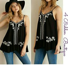 NEW BLACK EMBROIDERY RUFFLED TOP Solid black ruffled tank featuring white embroidery detailing throughout. Adjustable straps. Non sheer.Unlined. Woven. Light weight. Available in S,M,L PLEASE COMMENT SIZE 100%RAYON 4 Bidden Boutique Tops Tank Tops