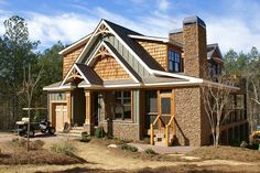 Rustic style house plan with porches, stone fireplace and photos. Will work great on a corner lot at the lake or in the mountains. Visit us to view all of our rustic style plans.