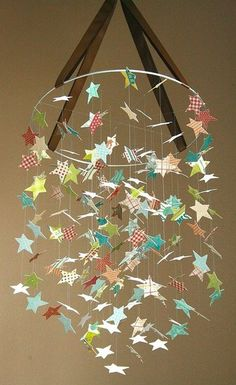 Falling stars- Thinking of doing this with plastic glow in the dark stars for the Little's room since it is done in space theme.