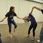 Students race to pass a hula hoop around each other while holding hands as they play cooperative games while participating in the Building Leaders And Strong Tomorrows Youth Group Games, Youth Activities, Team Building Activities, Activity Games, Family Games, Fun Games, Games For Kids, Party Games Group, Youth Groups