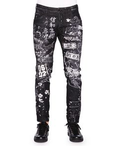 """DSquared2 """"Skater"""" style jeans with allover graffiti-style print and light distressing. Approx. measurements: 8"""" front rise, 30"""" inseam, 38"""" outseam, 12"""" leg opening. Five-pocket style; additional zip"""