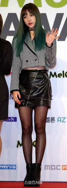 Asian girl in black leather miniskirt hose ankle boots