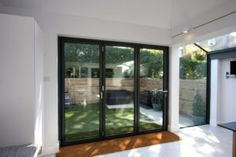 #Modernextension on Onslow Avenue installed three-pane #bifolding door with a minimal sightline of only 120mm.