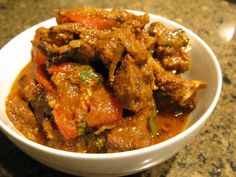 Curry goat is a curry dish prepared with goat meat. The dish originated in the Indian subcontinent; and has become popular in Southeast Asian and Indo-Caribbean cuisine Goat Recipes, Indian Food Recipes, Cooking Recipes, Healthy Recipes, Ethnic Recipes, Kerala Recipes, Indian Foods, African Recipes, Slow Cooking