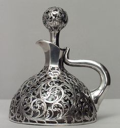 French Victorian silver deposit scroll design decanter with handle and stopper.