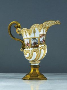 Meissen ewer.  nautilus with polychrome scenes of bustling harbors and hunting scenes in rectangular frames. 1740