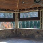 Check out our blog for the big reveal of this vinyl shade install. Fabulous home and innovative and versatile product from #phantomscreens. #deck #porch #luxuryhome #outdoorspace http://retractingsolutions.com/the-vinyl-frontier