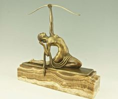 Art Deco bronze sculpture of a female archer by Marcel BOURAINE 1930, depicting a naked young woman with length of cloth draped across lap, kneeling backwards and aiming with a bow towards the sky. On a stepped rectangular onyx base. By Marcel André Bouraine (1886-1948).