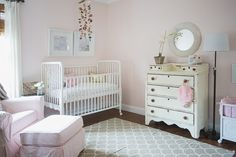 Beachy Chic: This extra cute beach-inspired nursery combines coastal decor with pretty pinks and vintage furniture.