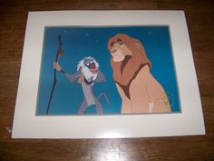 Walt Disney's The Lion King - 1995 Gold Seal Lithograph starring Simba and Rifiki  This listing is for a Disney Store lithograph from the Lion King. The lithograph itself measures approximately. 11 inches x 14 inches with an image size of approximately. 10 3/4 inches by 7 3/4 inches and comes with a white colored mat with a grey trim line.