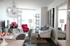 White room with mix of vintage and contemporary furniture. Beautiful chandeliers.