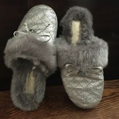 Silver Sparkly Michael Kors slippers Cozy fur inside with rubber soles that were rarely worn. Shoes Slippers