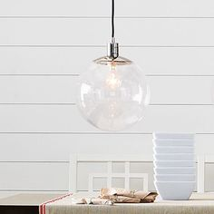 Love this West Elm globe pendant, especially with the long Edison-style bulb. This would look awesome in a bathroom or kitchen with high ceilings.