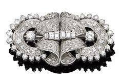 A diamond double-clip brooch, circa 1935 Each pierced brooch of scrolling design, set throughout with brilliant, single and baguette-cut diamonds, diamonds approx. 3.80cts total, width 5.4cm